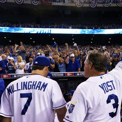 Manager Ned Yost #3 of the Kansas City Royals waves ot the fans after they defeated the Oakland Athletics 9 to 8 in the 12th inning of their American League Wild Card game at Kauffman Stadium on September 30, 2014 in Kansas City, Missouri.