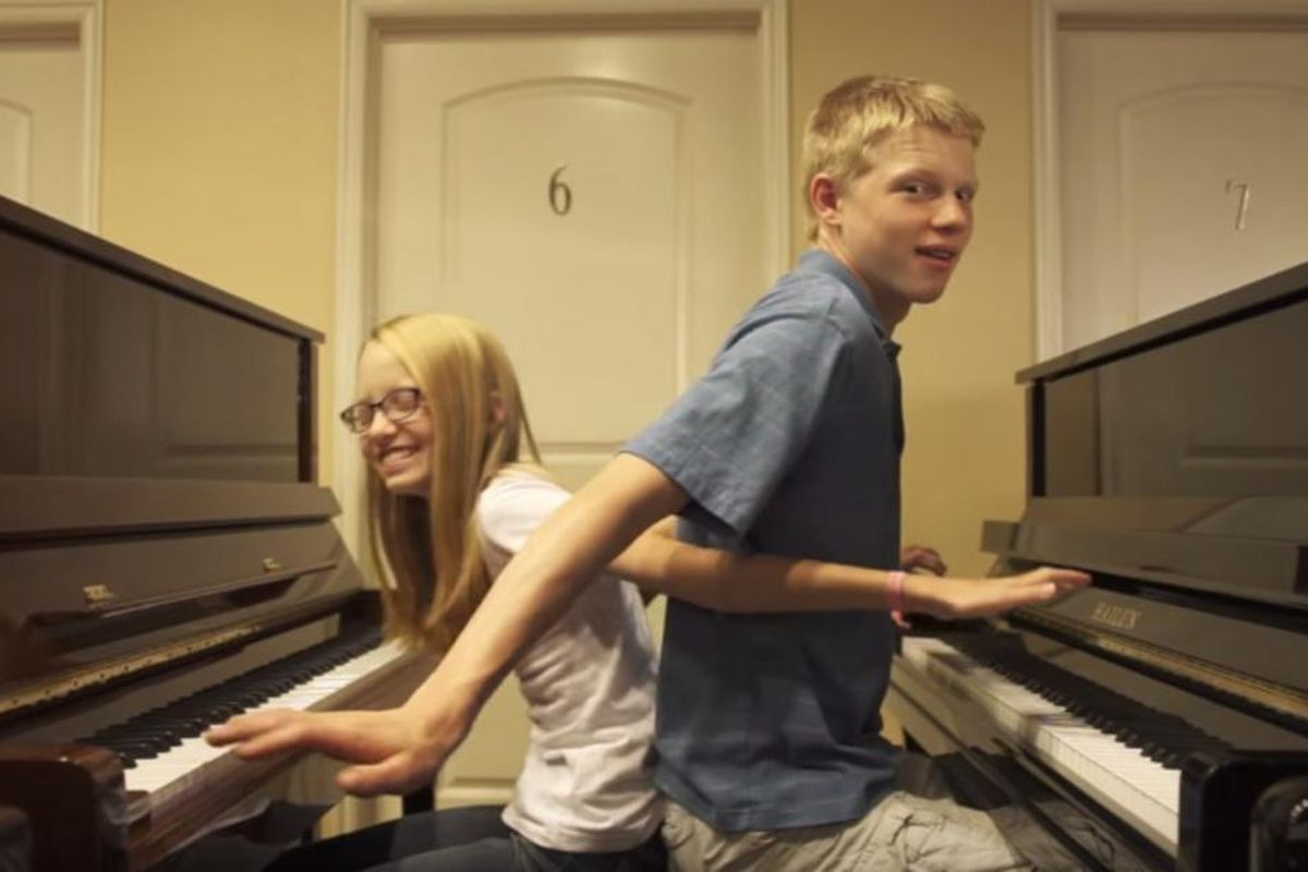 """The Piano Gal, Sara Black, and Nathan Shaumann played a duet to \""""Shut Up and Dance with Me,\"""" by Walk the Moon"""