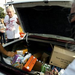 Jerry Dolejs watches as food items are loaded into his car at the Utah Food Bank mobile pantry at The Church of Jesus Christ of Latter-day Saints' Cannon Stake Center in Salt Lake City on Wednesday, Sept. 1, 2021. Dolejs keeps a few items for himself and gives the majority of the food to his neighbor, who has a large family.
