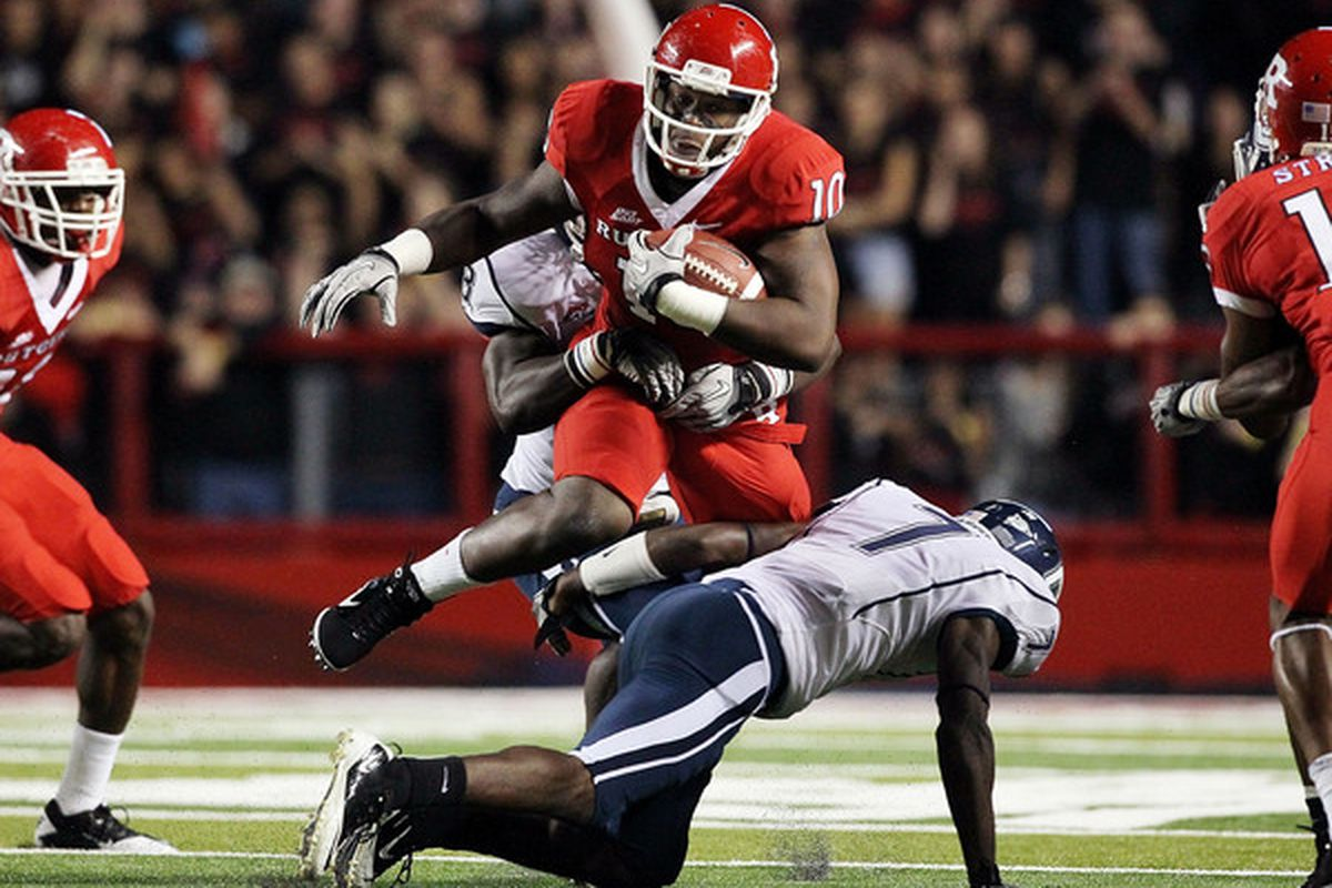 PISCATAWAY, NJ - OCTOBER 08:  D.C. Jefferson #10 of the Rutgers Scarlet Knights runs the ball over Mike Lang #7 of the Connecticut Huskies at Rutgers Stadium on October 8, 2010 in Piscataway, New Jersey.  (Photo by Jim McIsaac/Getty Images)