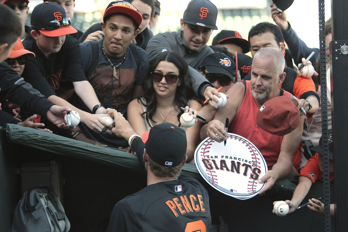 August 1, 2012; San Francisco, CA, USA; San Francisco Giants right fielder Hunter Pence (8) signs autographs for fans before the game against the New York Mets at AT&T Park. Mandatory Credit: Kelley L Cox-US PRESSWIRE