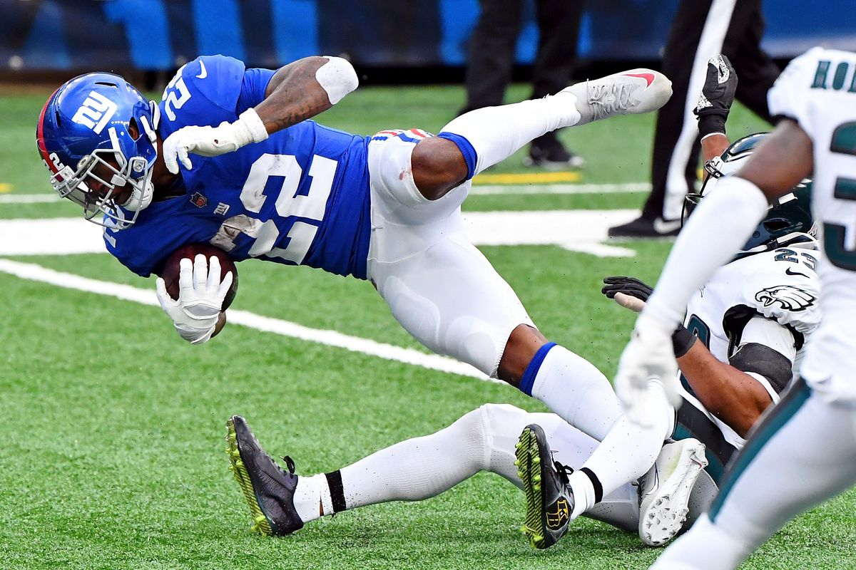 New York Giants running back Wayne Gallman (22) is tackled as he makes a first down against the Philadelphia Eagles during the second half at MetLife Stadium.