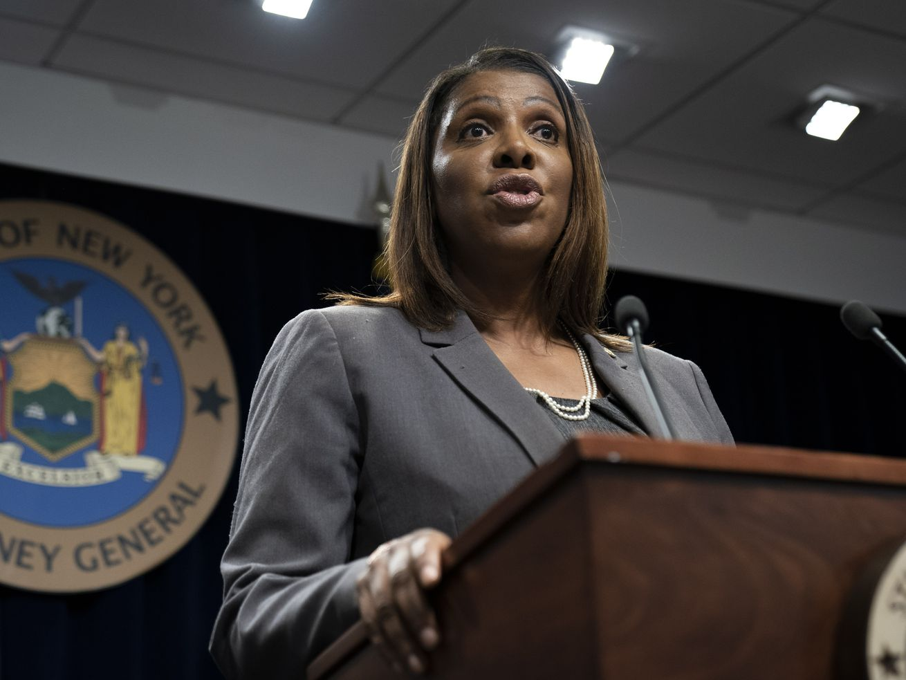 New York State Attorney General Letitia James speaking at a rostrum.