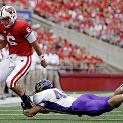Wisconsin quarterback Danny O'Brien breaks away from Northern Iowa's Jake Farley during the first half of an NCAA college football game Saturday, Sept. 1, 2012, in Madison, Wis.