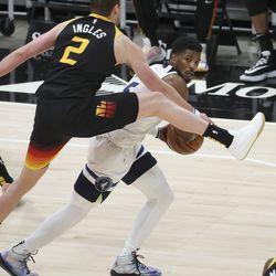 Utah Jazz forward Joe Ingles (2) defends Minnesota Timberwolves guard Malik Beasley (5) in Salt Lake City on Saturday, Dec. 26, 2020.