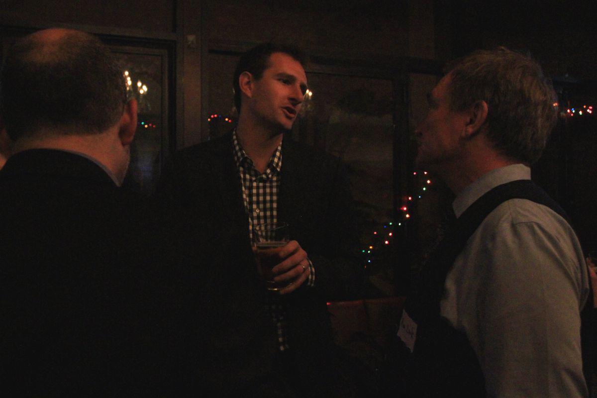 Chalkbeat New York reporter Geoff Decker talks with attendees.