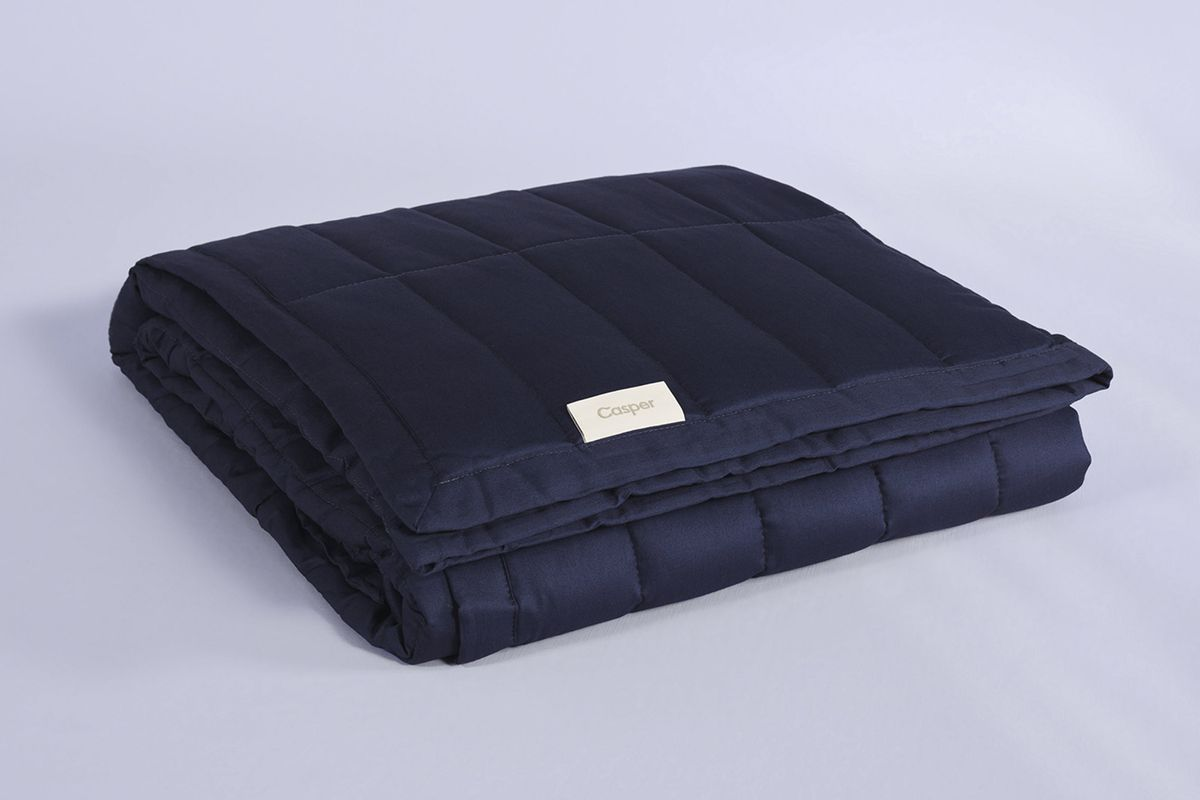 Dark blue quilted blanket.