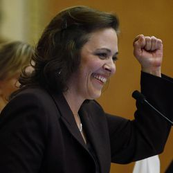 House Speaker Becky Lockhart, R-Provo reacts following the legislative session in the House of Representatives at the Capitol in Salt Lake City on Friday, March 14, 2014. Lockhart, the first woman to serve as Utah House speaker, died at her home Saturday, Jan. 17, 2015, from an unrecoverable and extremely rare neurodegenerative brain disease. She was 46.