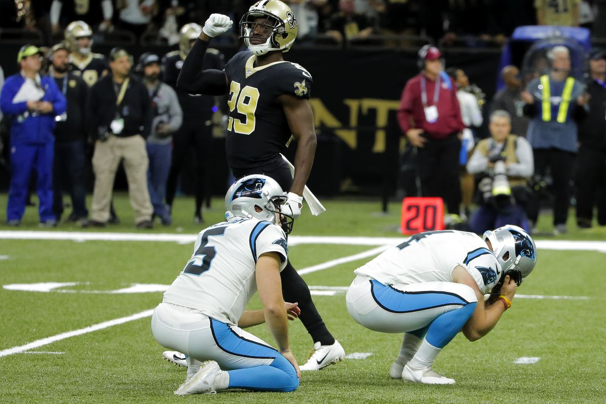 New Orleans Saints defensive back Johnson Bademosi celebrates as Carolina Panthers kicker Joey Slye reacts to missing a field goal during the fourth quarter at the Mercedes-Benz Superdome.