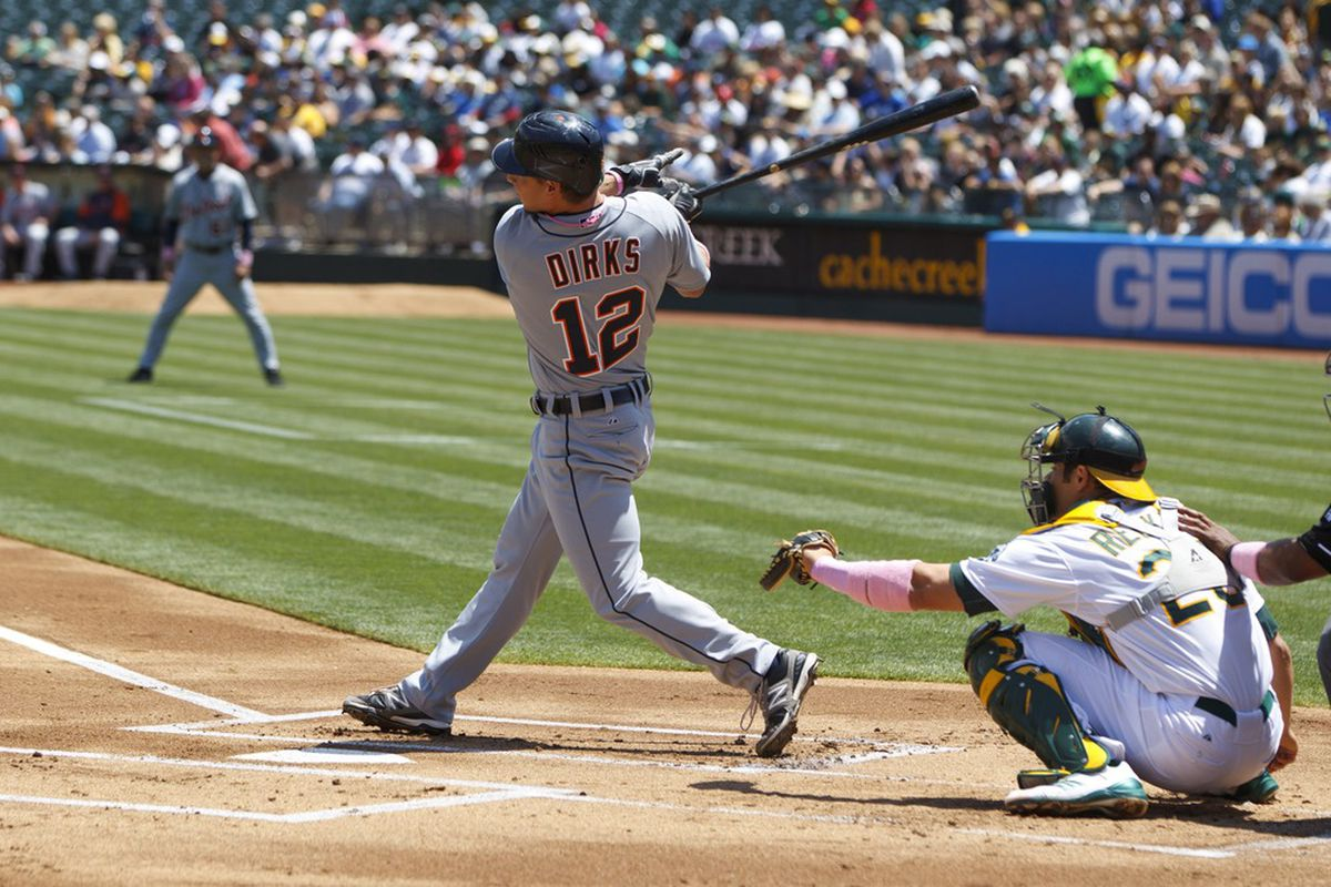 OAKLAND, CA - MAY 13: Andy Dirks #12 of the Detroit Tigers hits a single against the Oakland Athletics during the first inning at O.co Coliseum on May 13, 2012 in Oakland, California.