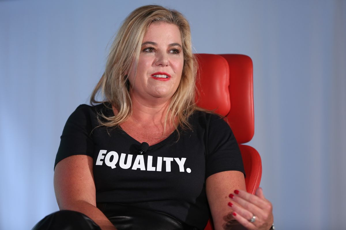 Nike Direct President Heidi O'Neill sits in a red chair on stage at Recode's Code Commerce 2017 conference in New York City.