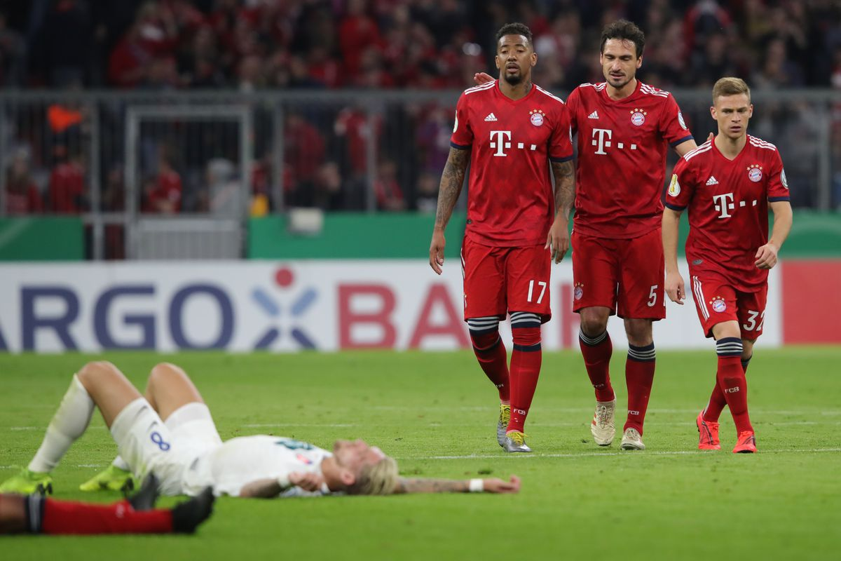 Bayern Muenchen v 1. FC Heidenheim - DFB Cup MUNICH, GERMANY - APRIL 03: Jerome Boateng, Mats Hummels and Joshua Kimmich (back, L-R) of Muenchen and Marc Schnatterer of Heidenheim react after the DFB Cup quarterfinal match between Bayern Muenchen and 1. FC Heidenheim at Allianz Arena on April 03, 2019 in Munich, Germany.