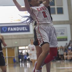 East's Margarita Satini puts up a shot while guarded by Timpview's Ella Pope during East's 68-48 victory against Timpview in the Class 5A state championship game at Salt Lake Community College in Taylorsville on Saturday, Feb. 24, 2018.