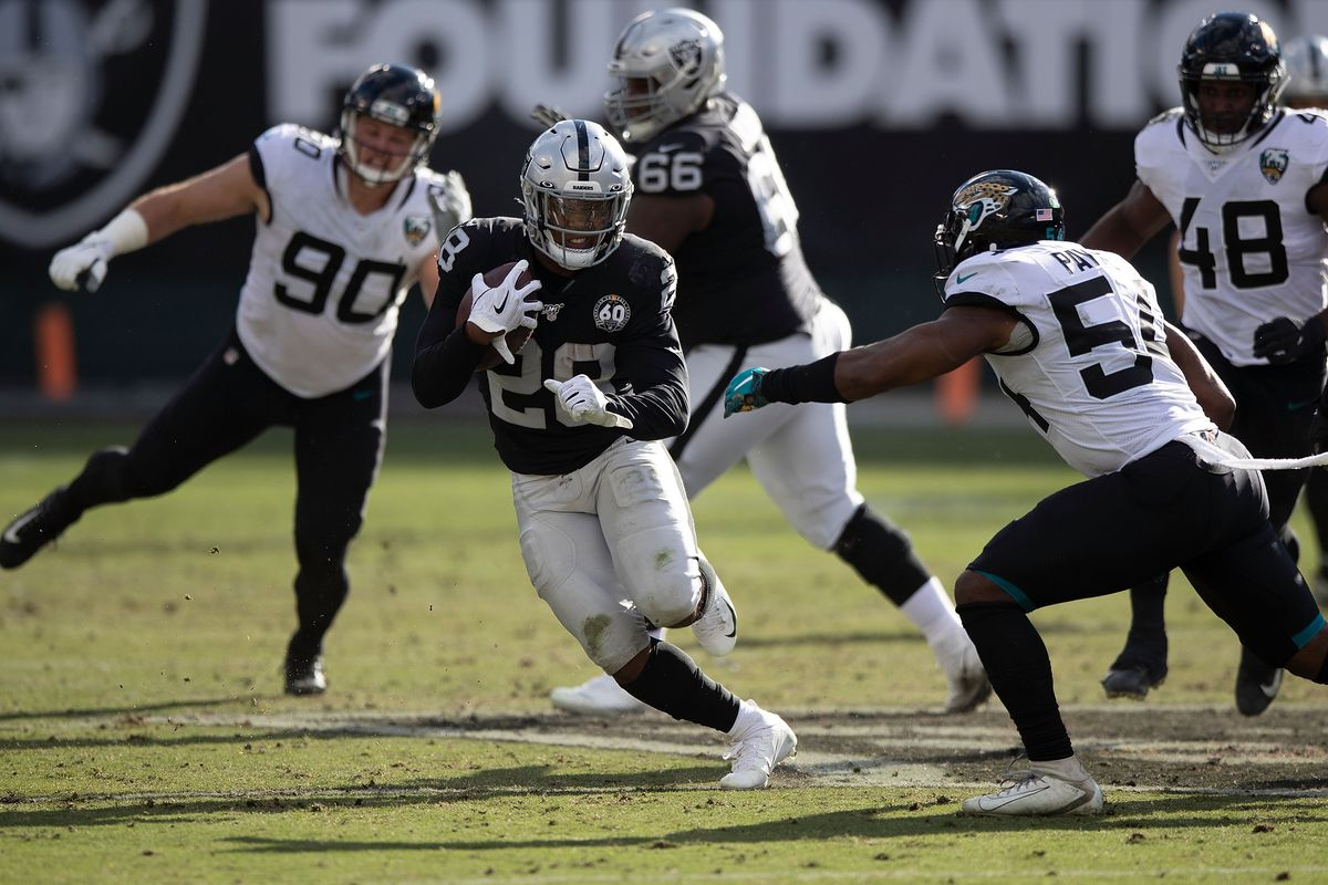 Running back Josh Jacobs of the Oakland Raiders rushes up field against the Jacksonville Jaguars during the second quarter at RingCentral Coliseum on December 15, 2019 in Oakland, California.
