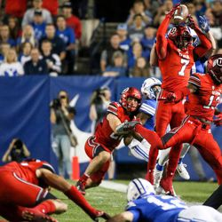 Utah Utes defensive back Jaylon Johnson (7) intercepts a pass from Brigham Young Cougars quarterback Tanner Mangum (12), but the play is ruled an incomplete pass, at LaVell Edwards Stadium in Provo on Saturday, Sept. 9, 2017.