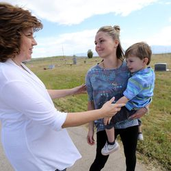 Traci Mariano, Jordan School District administrative assistant, hugs Tessa Stitzer and her son, Drake Stitzer, goodbye at the Bingham City Cemetery in Copperton on Thursday, May 25, 2017. The Jordan School Board has deeded the pioneer cemetery to Copperton Township after 44 years as owner and caretaker. Stitzer serves on the township council and was insistent that the township reassume ownership.