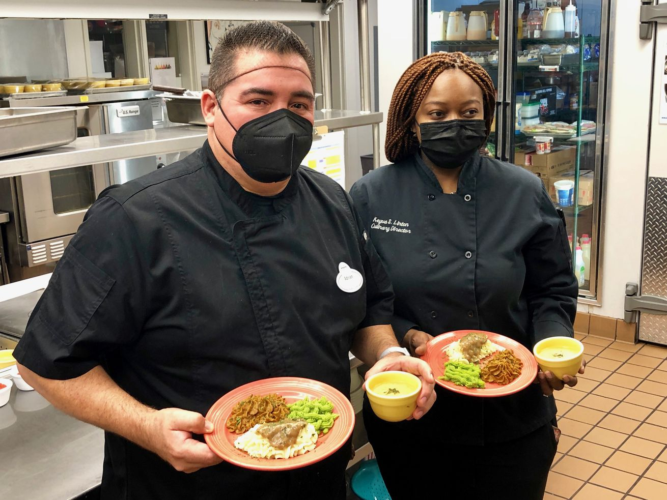 Chefs Adrian Arias, left, and Keyva S. Linton show off plates of pureed food that has been styled back into its original shapes at Northbrook Inn, a memory care facility providing special meals to residents who have trouble swallowing due to dementia.