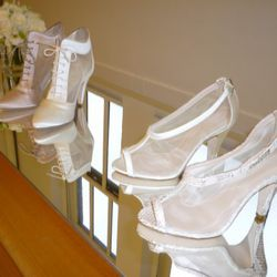 On left: Giorgia-SA satin with mesh lace-up bootie ($625); On right: Noelle satin with mesh peep-toe pump ($495)