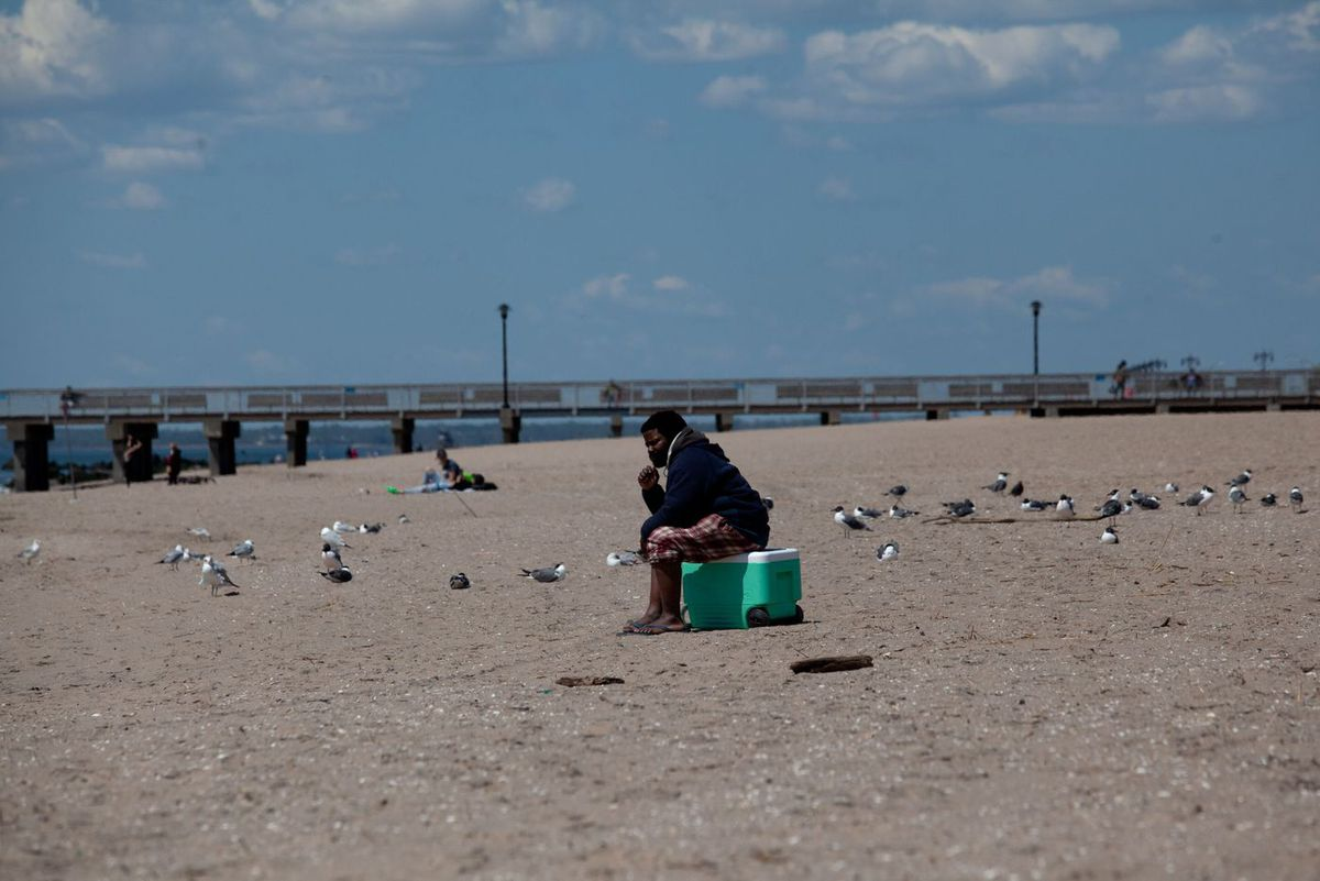 People socially distance at Coney Island during the coronavirus outbreak.
