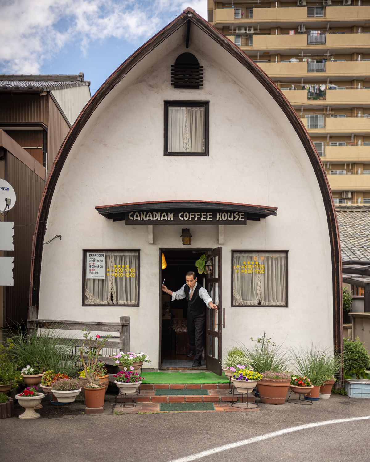 Mr. Sakai reaches out to shut the door at Canadian Coffee House