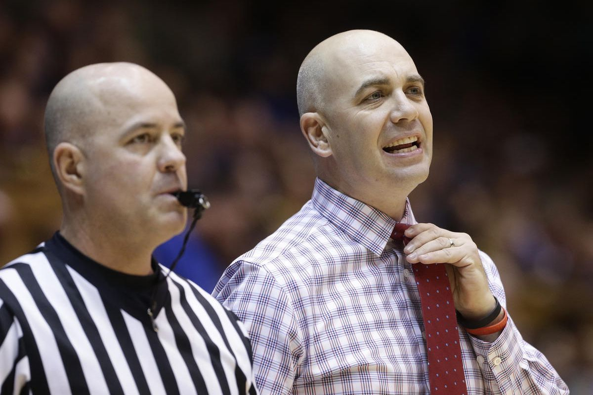 South Dakota head coach Craig Smith speaks with an official during the first half of an NCAA college basketball game against Duke in Durham, N.C., Saturday, Dec. 2, 2017. (AP Photo/Gerry Broome)