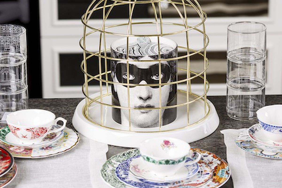 Photo: Twintable bird cage and Fornasetti candle at Citizen Stone