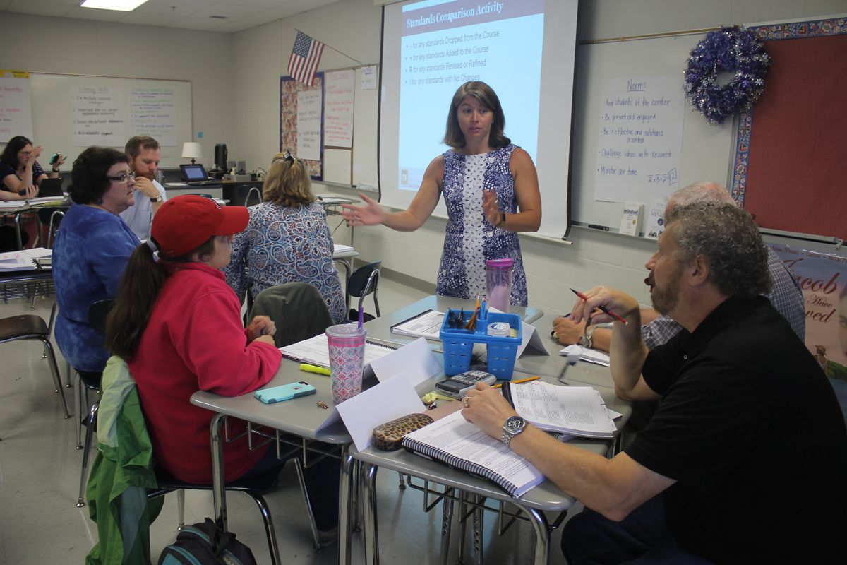 Erin McGill, a facilitator for trainings organized by the Tennessee Department of Education, dives into the revised standards with high school math teachers. (Photo by Marta W. Aldrich)