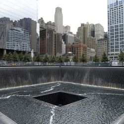FILE - In this Sept. 6, 2011 file photo, the World Trade Center North Tower memorial pool at the National September 11 Memorial and Museum is seen against the New York City skyline. The foundation that runs the memorial estimates that once the roughly $700 million project is complete, it will cost $60 million a year to operate.
