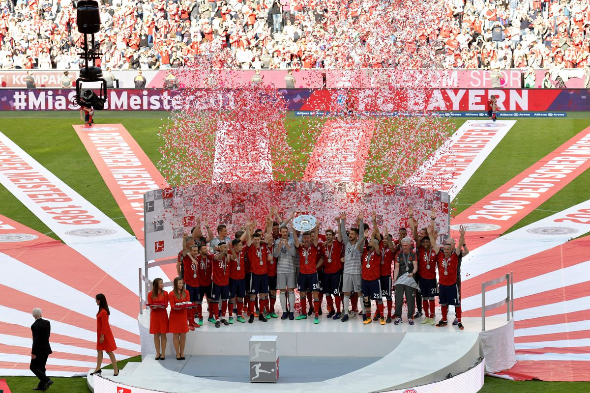 Bayern Munich's German forward Thomas Mueller lifts the trophy during the celebration for the 28th German football championship after the German first division Bundesliga football match FC Bayern Munich vs VfB Stuttgart in Munich, southern Germany, on May 12, 2018.