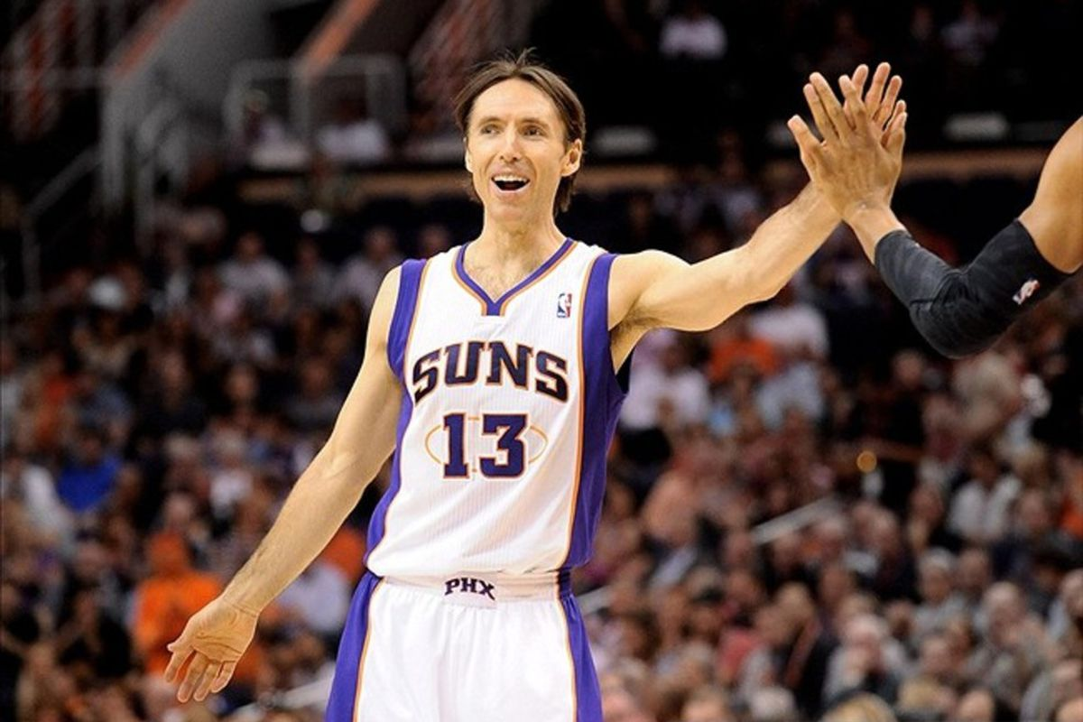 Mar. 14, 2012; Phoenix, AZ, USA; Phoenix Suns guard Steve Nash (13) is high fived while playing against the Utah Jazz during the first half at the US Airways Center. Mandatory Credit: Jennifer Stewart-US PRESSWIRE.