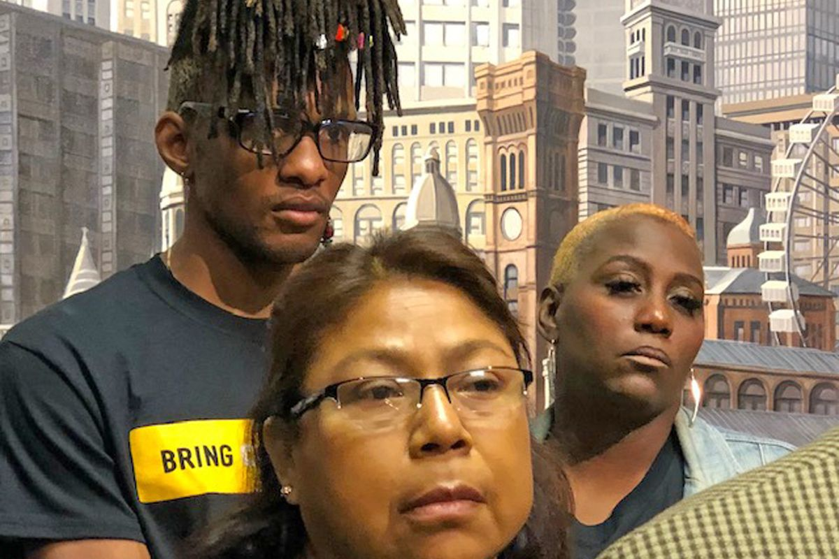 Lake View H.S. graduate Dontay Lockett (left) and Bridgette Barber (right), a grandmother and guardian of two CPS students, at a City Hall news conference Thursday.