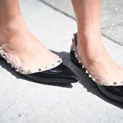 """Anh of <a href=""""http://9to5chic.com"""">9to5 Chic</a> rocks Valentino flats like the stylish mom-to-be that she is."""