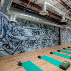 The Springs's cool yoga studio, located in the back of the space, also features a rad mural. The studio offers a variety of classes including hatha, flow, power flow, kundalini, restorative, yoga dance, meditation, and more. A single class goes for an eas