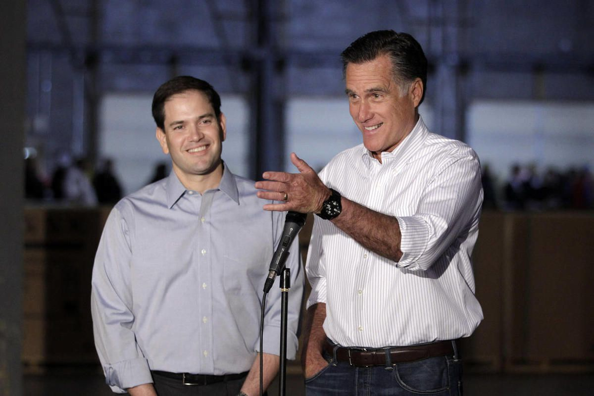 Republican presidential candidate, former Massachusetts Gov. Mitt Romney, accompanied by by Sen. Marco Rubio, R-Fla., talks to reporters in Aston, Pa., Monday, April 23, 2012.