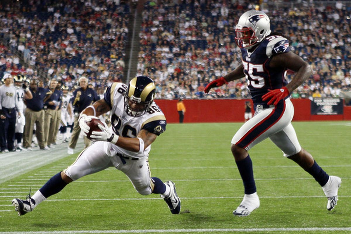 FOXBORO MA - AUGUST 26:  Michael Hoomanawanui #86 of the St. Louis Rams scores a touchdown as Brandon Spikes #55 of the New England Patriots defends on August 26 2010 at Gillette Stadium in Foxboro Massachusetts.  (Photo by Elsa/Getty Images)