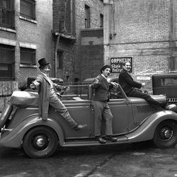 The Marx Brothers playing around at the stage entrance of the Orphem theater in Ogden.