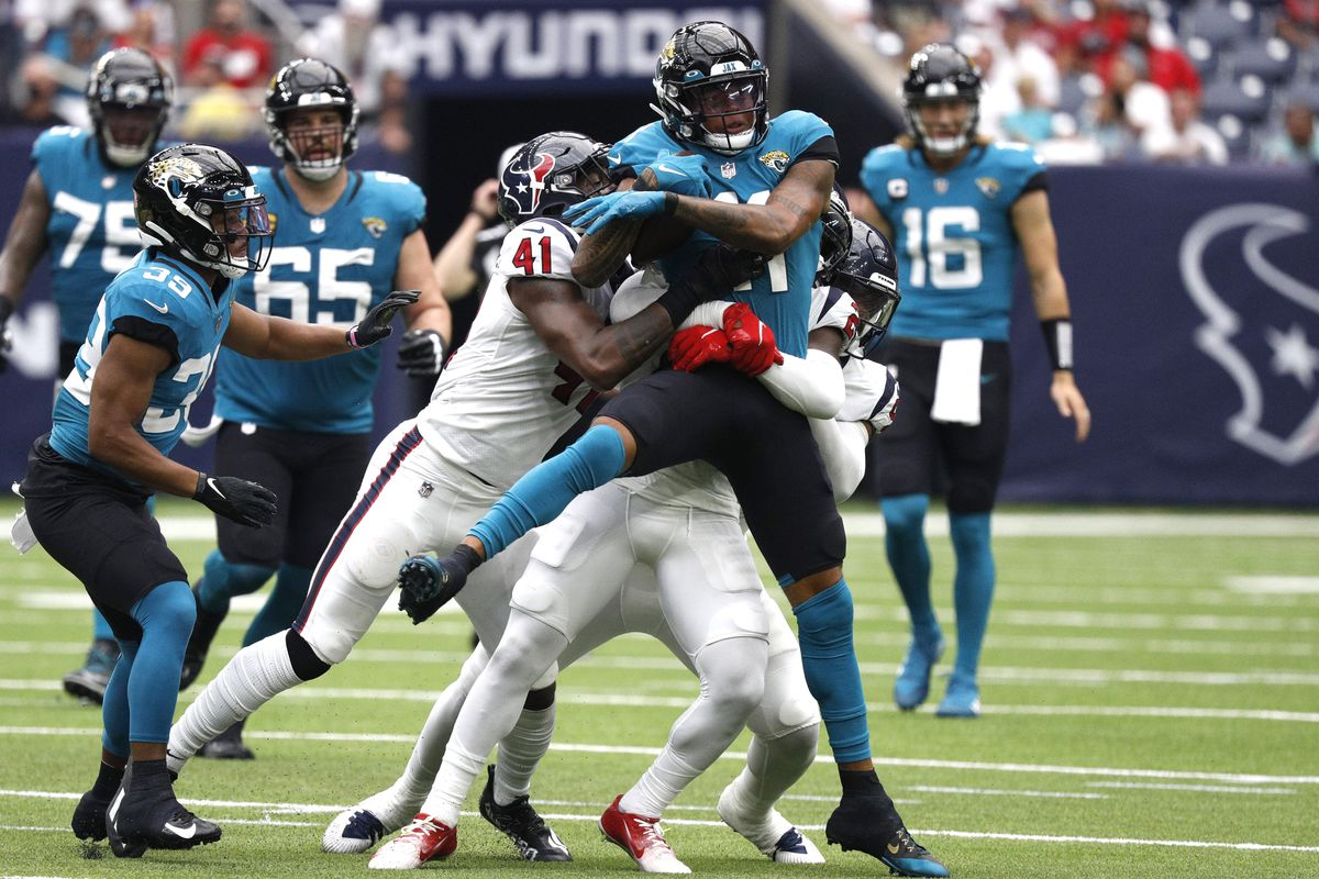 Marvin Jones #11 of the Jacksonville Jaguars is tackled following his reception by Zach Cunningham #41 of the Houston Texans during the game at NRG Stadium on September 12, 2021 in Houston, Texas.