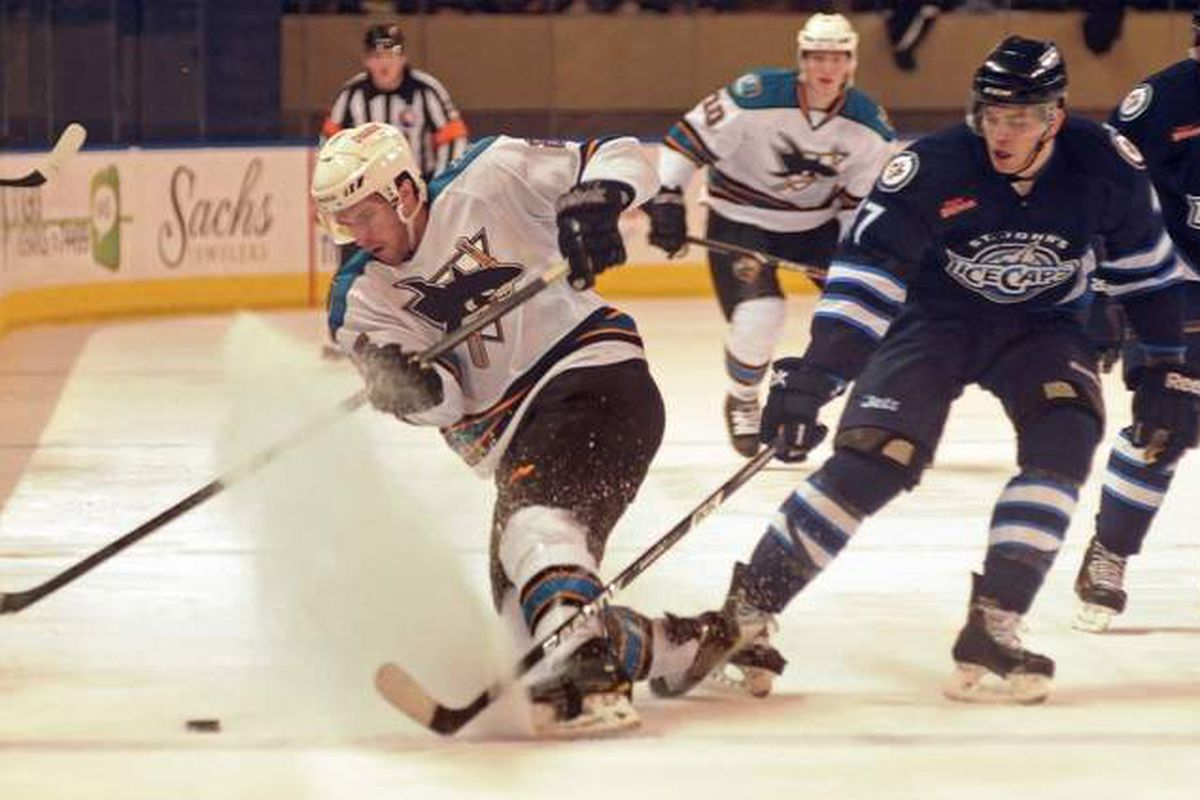 """Worceste Sharks forward Marek """"V"""" Viedensky, who scored what held up as the game-winning-goal, kicks up a snow shower while pursing a loose puck Friday night at the DCU Center."""