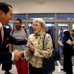LaVee Smith of Salt Lake City is greeted by Brian Murray, the manager of Macy's, on its opening day in the City Creek Center in Salt Lake City on Thursday, March 22, 2012.