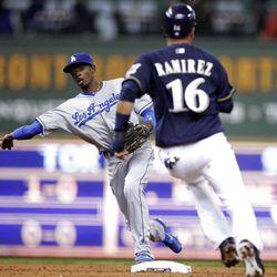 Los Angeles Dodgers' Dee Gordon, left, forces out Milwaukee's Aramis Ramirez.