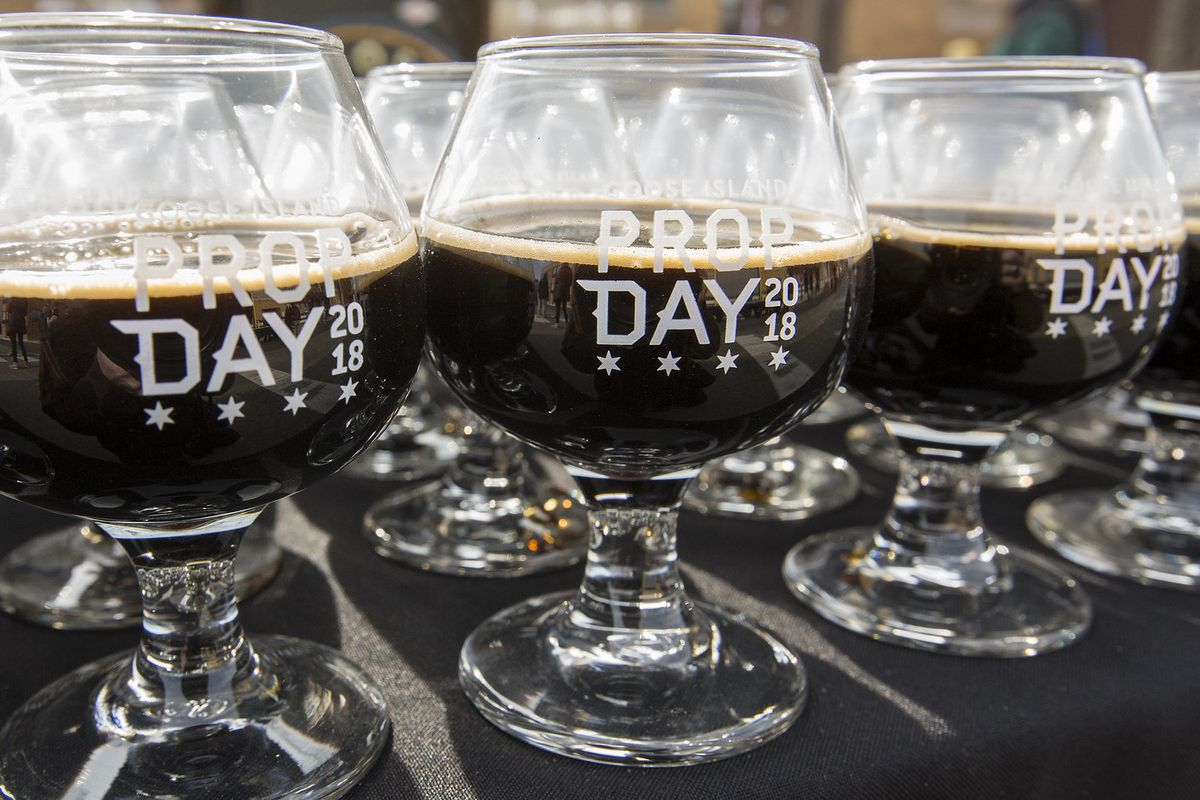 A group of beer glasses filled with stout.