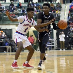 Orr's Tujautae Williams (22) drives around Curie's Damari Nixon (2) in their CPS semi final game at Chicago State University, Friday, February 15, 2019. | Kevin Tanaka/For the Sun Times