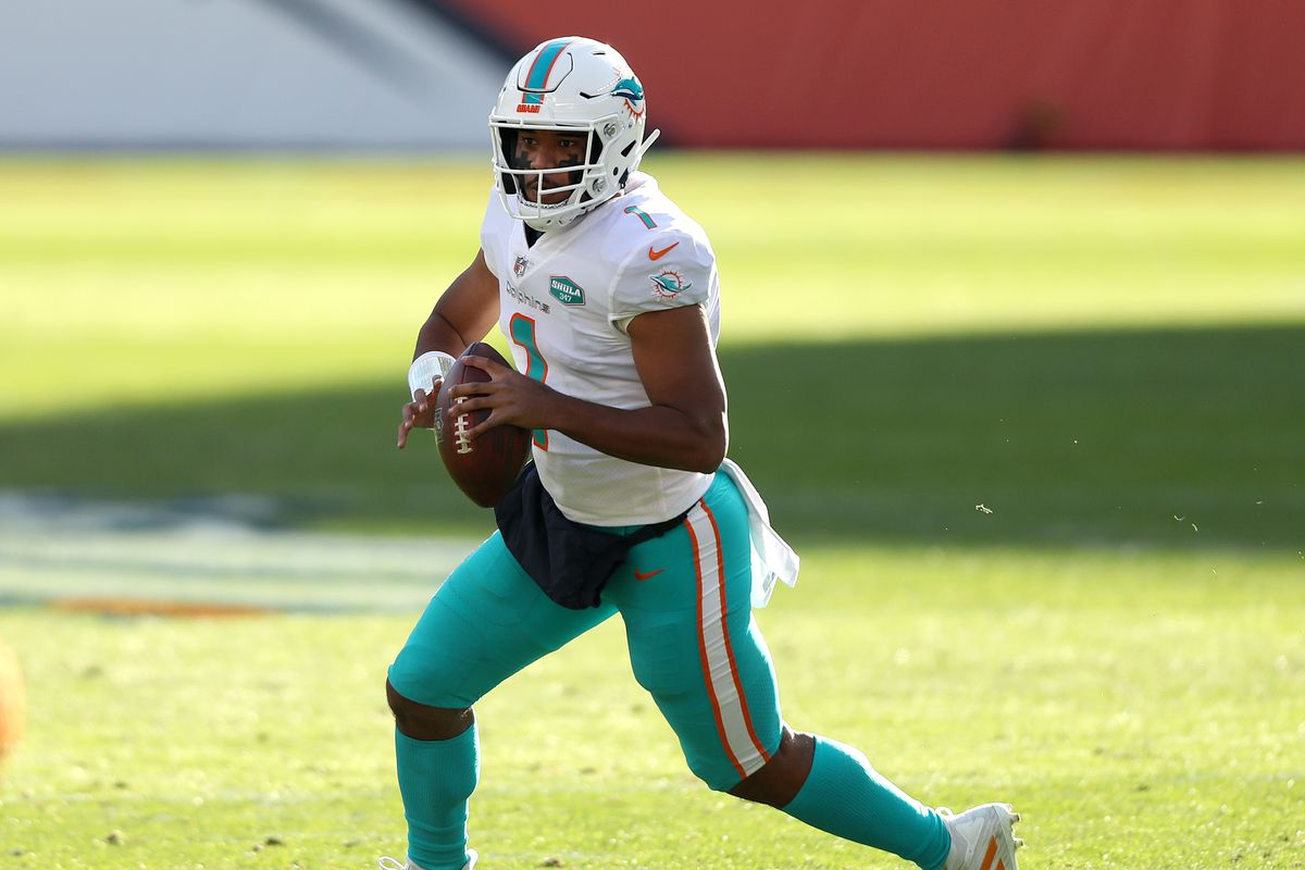 Tua Tagovailoa #1 of the Miami Dolphins rolls out of the pocket during the first quarter against the Denver Broncos at Empower Field At Mile High on November 22, 2020 in Denver, Colorado.