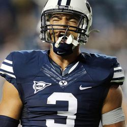 Brigham Young Cougars linebacker Kyle Van Noy celebrates a stop as BYU and Texas play Saturday, Sept. 7, 2013, at LaVell Edwards Stadium.