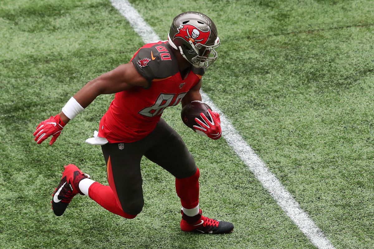 O.J. Howard of Tampa Bay Buccaneers runs with the ball during the NFL game between Carolina Panthers and Tampa Bay Buccaneers at Tottenham Hotspur Stadium on October 13, 2019 in London, England.