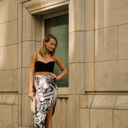 """Ashley of <a href=""""http://thestyleeditrix.com""""target=""""_blank"""">The Style Editrix</a> is wearing a <a href=""""http://us.zimmermannwear.com/readytowear/clothing/skirts/racer-motor-skirt.html?siteID=QFGLnEolOWg-oPxlrwJXq09c3kvjlctg_g""""target=""""_blank"""">Zimmermann<"""