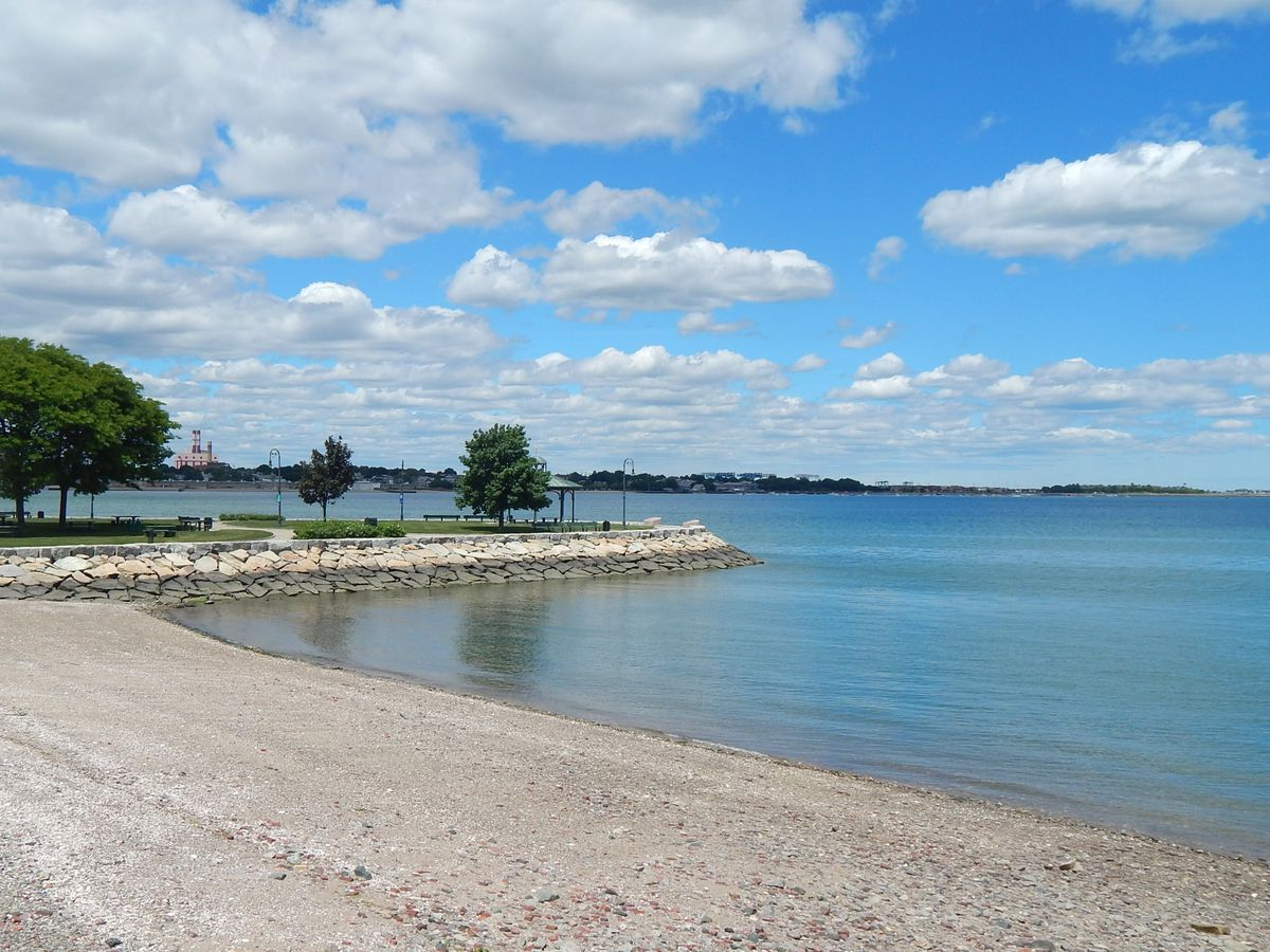 A sandy beach adjacent to a body of water.