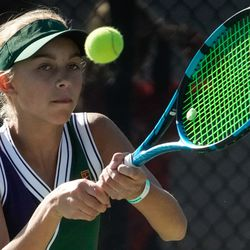 Bailey Huebner, of Green Canyon, returns the shot of Erika Olsen, of Bear River, during the first final singles match of the 4A girls tennis state tournament at Liberty Park Tennis Center in Salt Lake City on Saturday, Oct. 2, 2021.