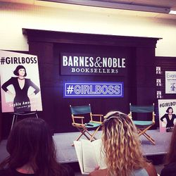 """<span class=""""credit"""">Lucky front-rowers reading their copy of #GIRLBOSS while they wait.</span>"""