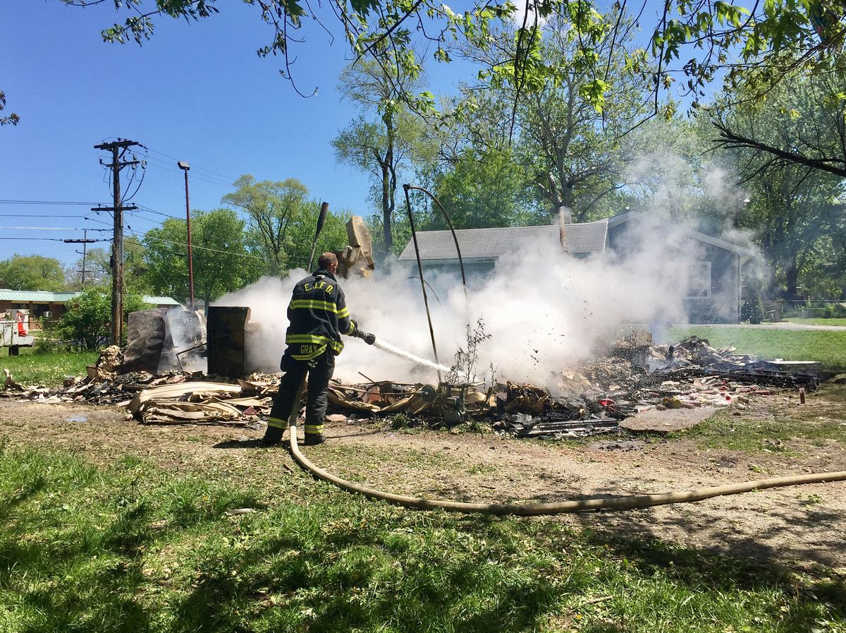 A firefighter on returned to the home to put out hot sports after a fire leveled the structure in May 2017. | Sam Charles/Sun-Times
